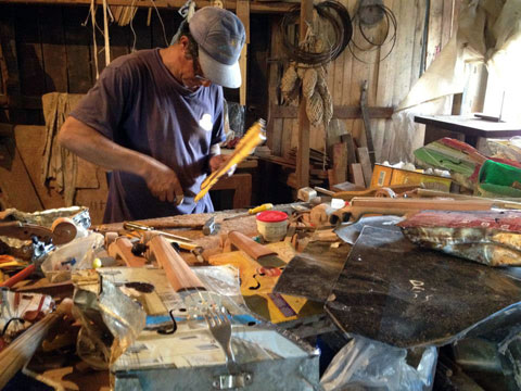 "This is where the magic starts. Nicolas Gomez, better known as ""Cola,"" building a recycled violin in his (also homebuilt) studio in Cateura."