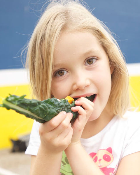 Meiners Oaks Elementary School student enjoying a raw kale taco.