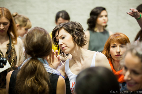 Kristen Arnett, makeup artist and founder of Green Beauty Team puts the finishing touches on models
